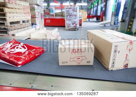 Gu'an, China - June 14, 2016: JD.com packages awaiting sorting at Northeast China based Gu'an distribution facility Gu'an, China