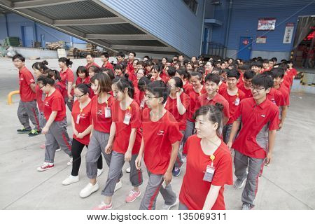 Gu'an, China - June 14, 2016: JD.com staff setting out to work at Northeast China based Gu'an warehouse and distribution facility