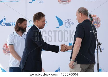 ST. PETERSBURG, RUSSIA - JUNE 4, 2016: Handshake of British skipper Adrian Lower (right) and Chairman of Management Committee of Gazprom Alexey Miller during the opening ceremony of Nord Stream Race
