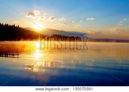 Beautiful Landscape With Mountains And Lake At Dawn In Golden Bl
