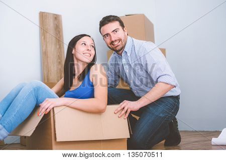 Young joyful couple during renovation and relocation home time