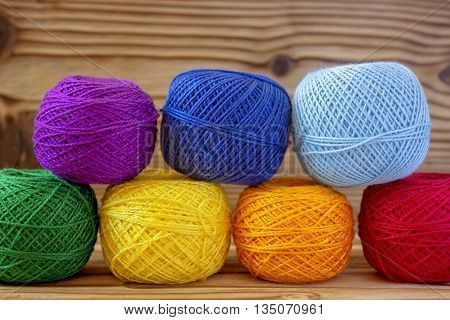 Rainbow balls of cotton yarn for knitting, crochet