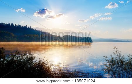 Beautiful lake with mountains in the background at sunrise. Slovakia Central Europe region Liptov