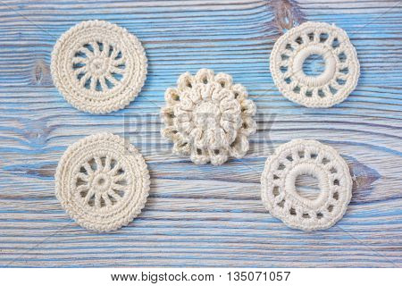 White Irish crochet knitted flowers for Christmas or Valentine's day. Background, knitted white elements. Crochet Christmas or Valentine's day ornaments