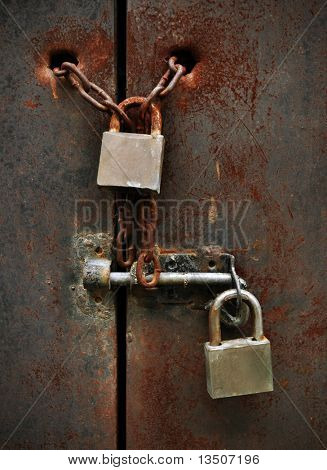 two lock on rusty iron door