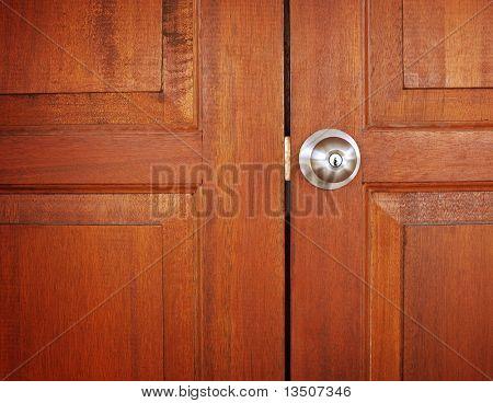 metal knob on wooden door