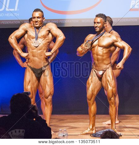 MAASTRICHT THE NETHERLANDS - OCTOBER 25 2015: Male bodybuilders celebrate their championship victory on stage at the World Grandprix Bodybuilding and Fitness of the WBBF-WFF