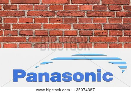 Nykobing, Denmark - June 12, 2016: Panasonic logo on a wall. Panasonic is a Japanese multinational electronics corporation headquartered in Kadoma, Osaka, Japan and it is one of the largest Japanese electronics producers
