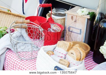 Background of bread and other bakery product. Composition of bread on a checkered napkin drapery background. Bread from wholemeal flour. Dishes for a picnic.