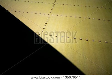metal surface of the aircraft fuselage sunny day