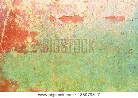 Grunge wall texture red green with chipped paint