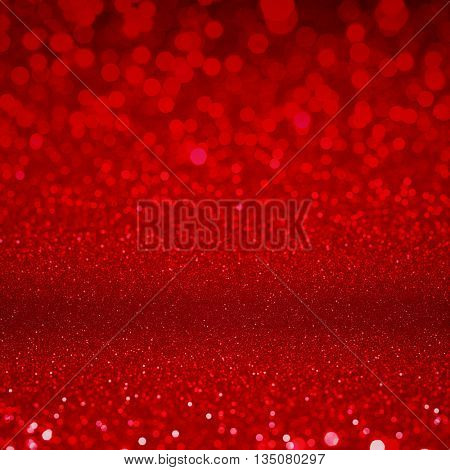 Glittering red lights background. Defocused red confetti abstract background.