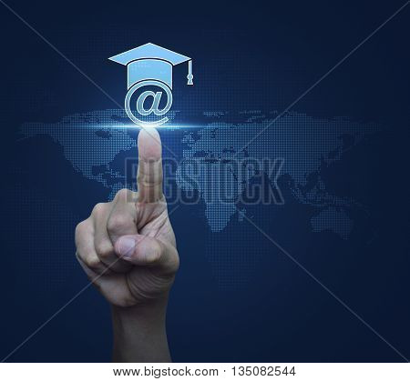 Hand pressing e-learning icon over digital world map blue background Study online concept Elements of this image furnished by NASA