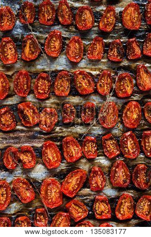 Dried tomatoes pattern - Food & Drink Homemade dried tomatoes with thyme, sea salt and olive oil on a tray