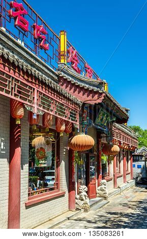 Beijing, China - May 15, 2016: Traditional storefront of a store in the city centre of Beijing