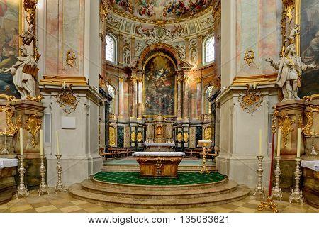 ETTEL GERMANY - FEBRUARY 12 2016: Altars inside Ettal Abbey a Benedictine monastery in the village of Ettal Bavaria Germany.