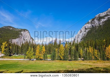 Autumn sunny day in the Canadian Rockies. Mountain valley in Banff National Park
