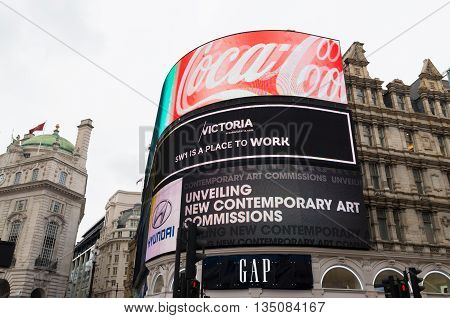 LONDON - OCTOBER 19 2015: famous neon billboards at piccadilly circus square one of the most wellknown places in the city