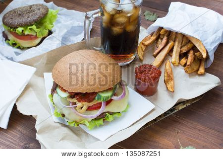 Fast food - fries with sauce and hamburgers