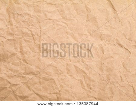 Brown crumpled wrapping kraft paper sheet background