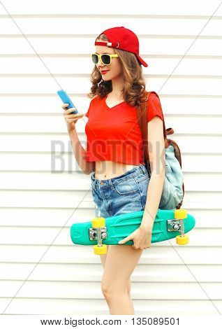 Fashion Pretty Cool Smiling Woman With Skateboard Using Smartpho