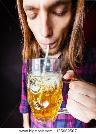 Young Man Drinking Pint.