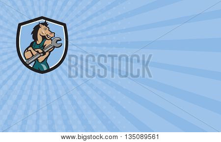 Business card showing illustration of a horse mechanic with arms crossed holding spanner looking to the side set inside shield crest on isolated background done in cartoon style.