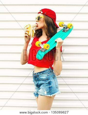 Fashion Pretty Cool Woman With Skateboard Eating A Banana Over W