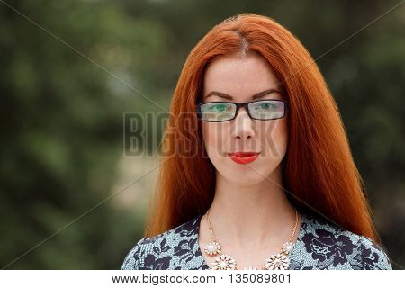 Ginger Woman Close Up Portrait On Green Background