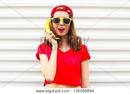 Portrait Pretty Cool Woman With Banana Having Fun Over White Bac