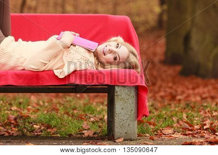 Woman Relaxing In Autumn Fall Park With Book.