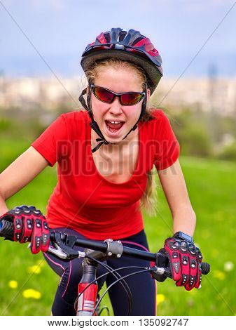 Bikes cycling girl. Girl rides bicycle out city. Girl girl happily shouts. Bicycle is good for health. Background city.