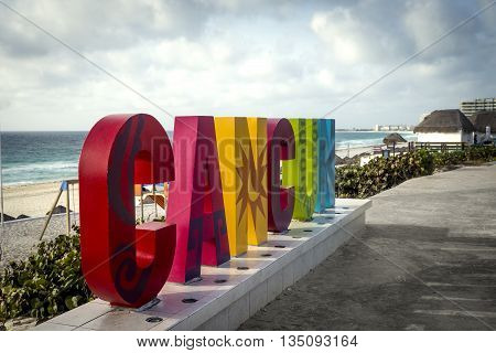 Colorful Cancun sign near the beach in mexico