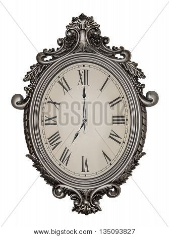 Seven o'clock. Antique wall clock isolated on white background.