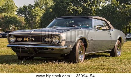 GROSSE POINTE SHORES MI/USA - JUNE 19 2016: A 1968 Chevrolet Camaro car at the EyesOn Design car show, held at the Edsel and Eleanor Ford House, near Detroit, Michigan.