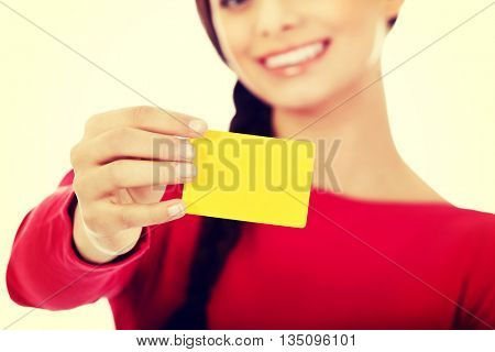 Young woman holding empty business card