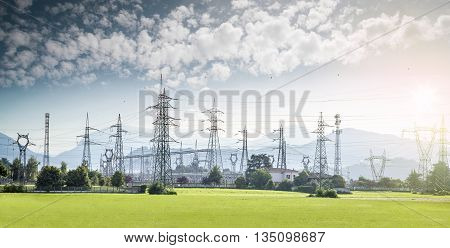 electricity towers and high voltage lines in a nice landscape