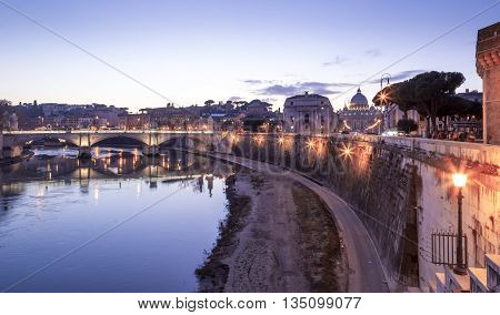 Rome Italy. Vatican dome of San Pietro and Sant Angelo Bridge over Tiber river