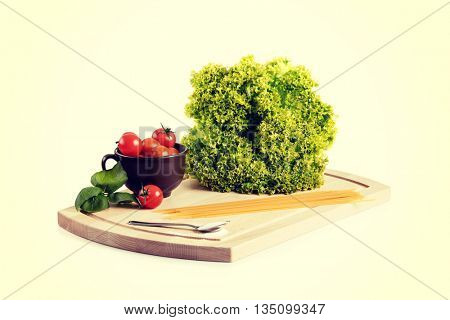 Food ingridients on wooden cutting board