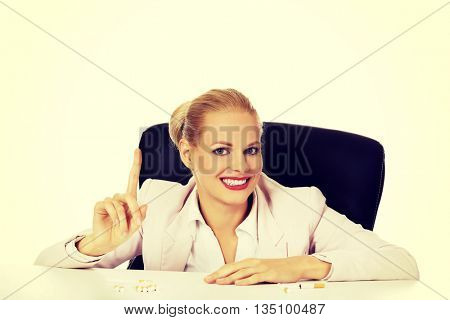 Smile business woman with several of cigarettes on the desk