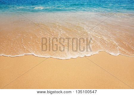 ocean background with soft waves on sandy ground, subtle vintage effect