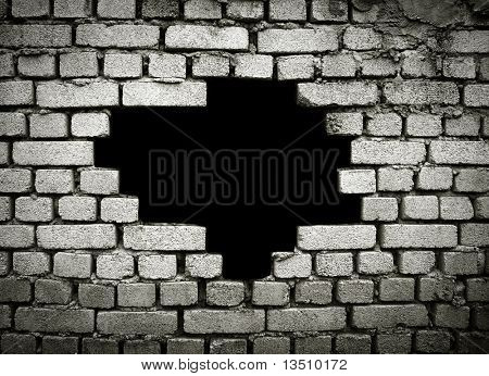 large hole on brick wall