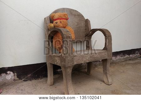 eddy bear siting on chair and toy teddy bear