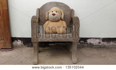 Teddy bear siting on chair and toy teddy bear