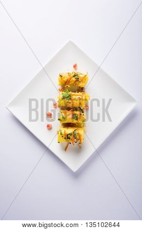 khandvi is a gujarati snack from India which is made with gram flour and curds tempered with sesame seeds and mustard seeds also known as Surali chya Vadya/Stuffed Khandvi, selective focus