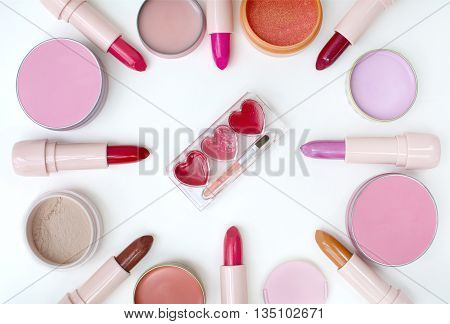 top view beauiful heart shap lip pallete and other item makeup