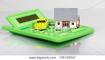 House with car and calculator.