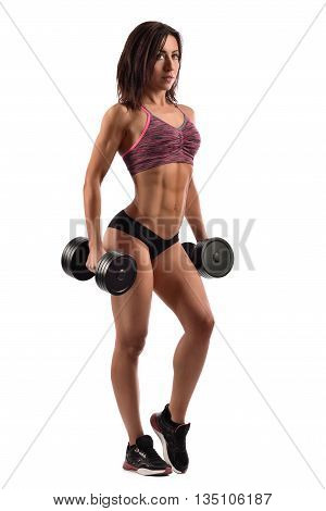 Summer alert. Vertical full length shot of a stunning sexy fitness woman posing with dumbbells in her hands showing off her toned body isolated on white