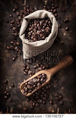 Coffe composition on dark rustic background with space for text