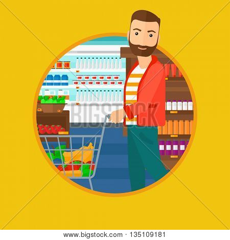 A hipster young man with the beard pushing a supermarket cart with some goods in it. Customer shopping at supermarket with cart. Vector flat design illustration in the circle isolated on background.